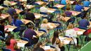Students taking an exam (Credit: Press Association)