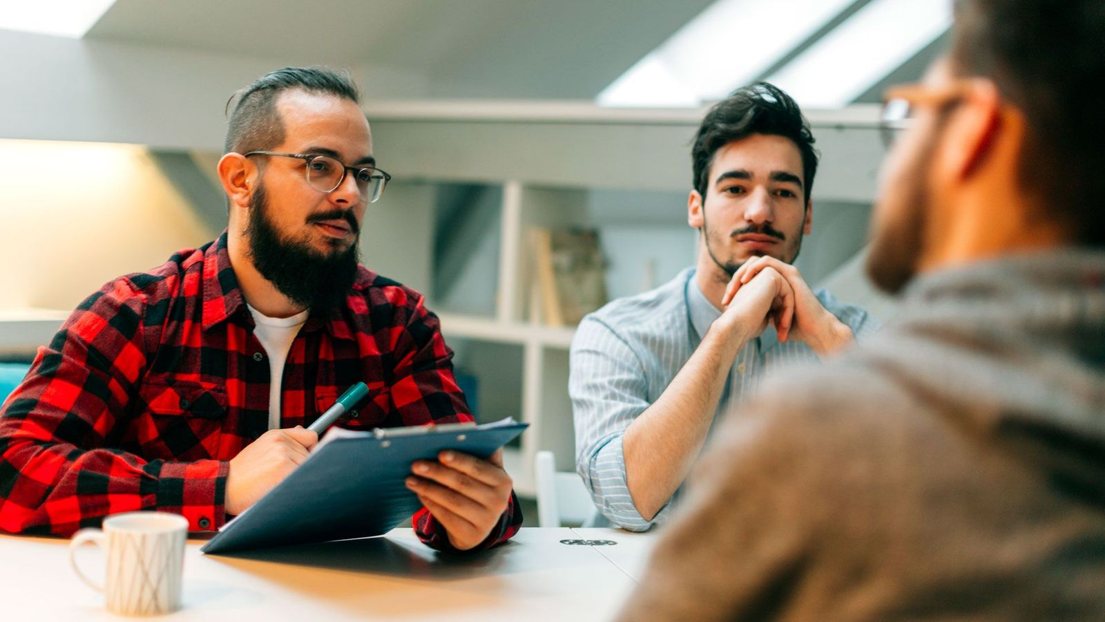 Recruiters hire candidates they think will fit with the company culture – but the practice is rife with biases (Credit: Getty Images)