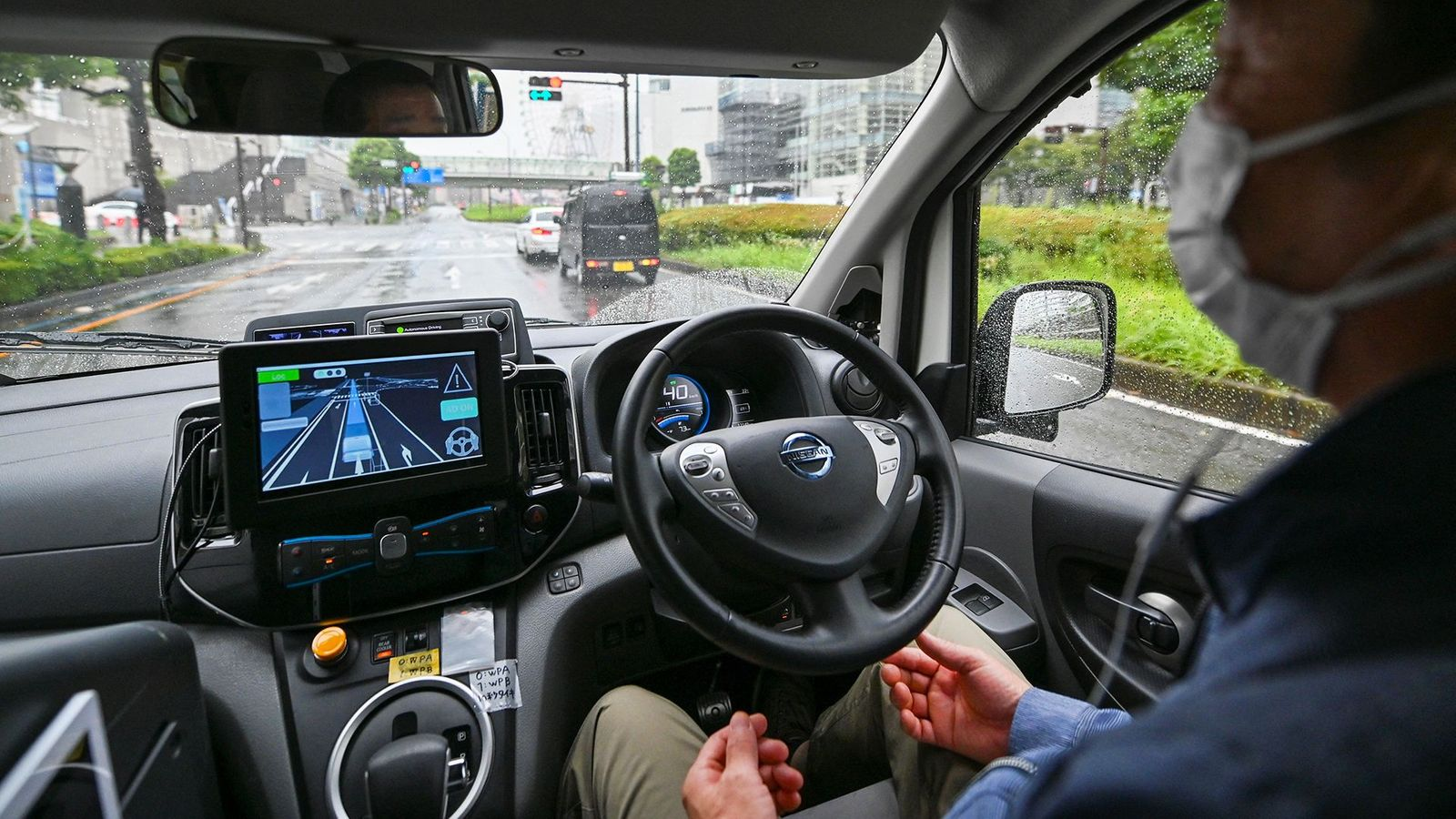 If we are to adopt self-driving vehicles it will require people to trust the technology entirely – will that be a good thing? (Credit: Kazuhiro Nogi/AFP/Getty Images)