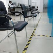Chairs spaced by tape in a bank in Moscow, Russia on 8 April 2020 thumbnail