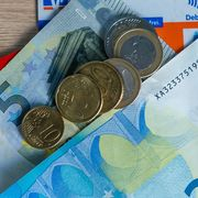 Cash and German bank cards on 25 March 2020 thumbnail