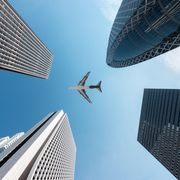 File image of a plane flying over skyscrapers thumbnail