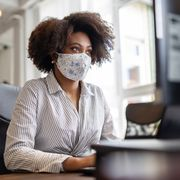 File image of masked worker in an office thumbnail