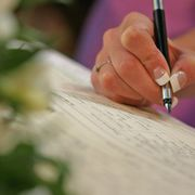 Woman signing the marriage registry - file image thumbnail