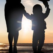 File image of the silhouettes of a mother and child thumbnail