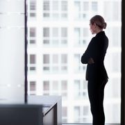 Office worker looking out of a window thumbnail