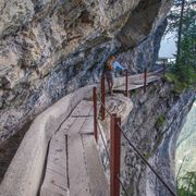 A hiker on the Bisse du Rho trail, Switzerland thumbnail