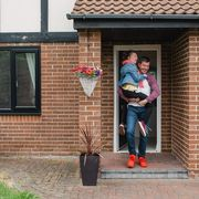 Father carries his daughter out of the house thumbnail