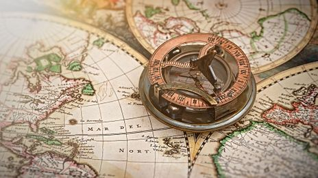 An old map, with compass (Credit: Credit: Studio13lights/Alamy)
