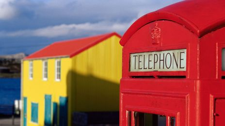 A British red telephone box and traditional house coexist in the Falkland Islands (Credit: Credit: robertharding/Alamy)