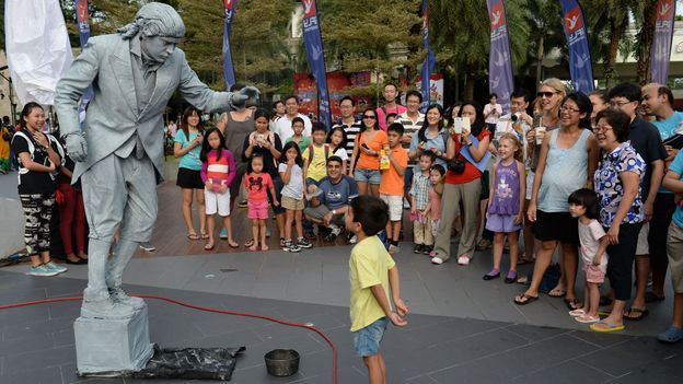 The Sentosa Buskers Festival in Singapore (Credit: Roslan Rahman/AFP/Getty)
