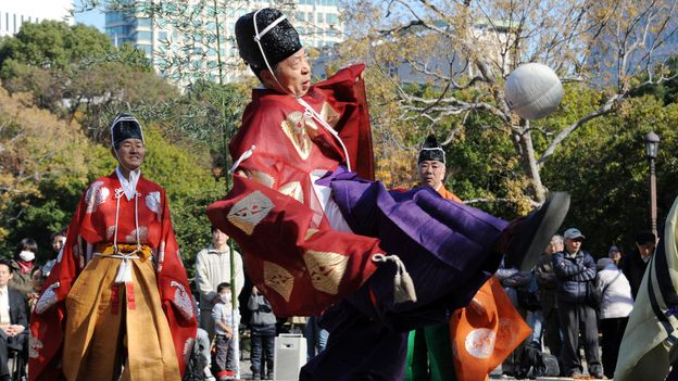 Playing kemari, an ancient Japanese ball-lifting game, in Tokyo (Credit: Rie Ishii/AFP/Getty)