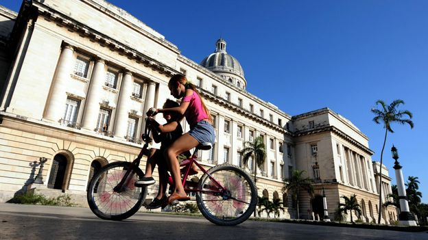 Biking by Cuba's capital (Credit: Rodrigo Arangua/AFP/Getty)