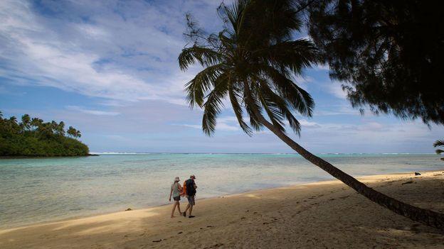 Seaside walks at Muri beach (Credit: Marty Melville/AFP/GettyImages)