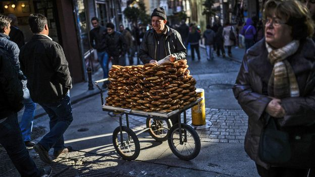 Selling simit, traditional Turkish pretzels, in the old quarter (Credit: Bulent Kilic/AFP/Getty)