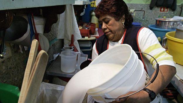 Bucket of pulque (Credit: Ronaldo Schemidt/AFP/Getty)