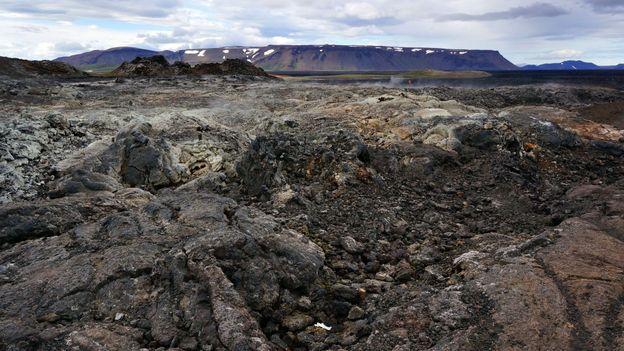 Smouldering, blackened lava fields (Credit: Anita Isalska)