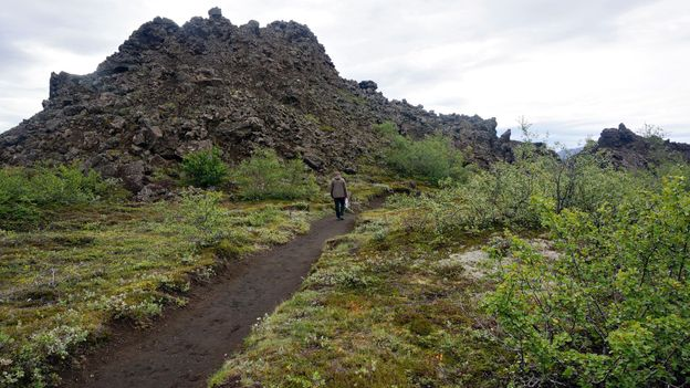 Hiking past volcanic rubble in Dimmuborgir (Credit: Anita Isalska)