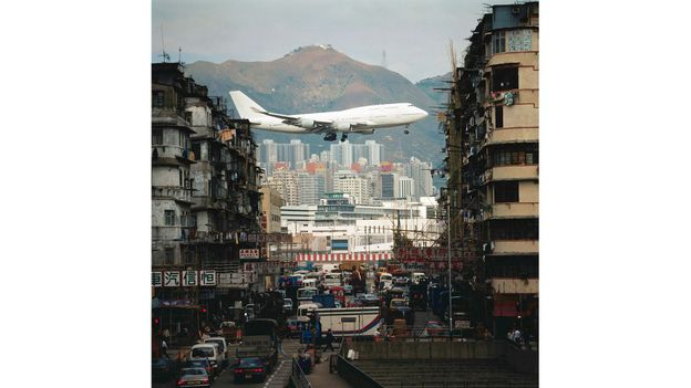 Planes approached near buildings at Hong Kong's now-closed Kai Tak Airport (Credit: Credit: Flirt/Alamy)