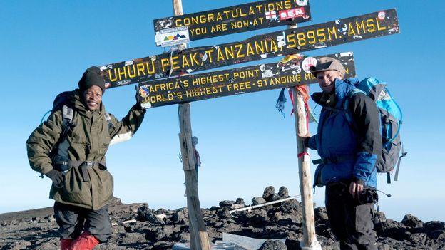 Atop Africa's highest peak, Mount Kilimanjaro (Credit: Credit: Michael Hodson)