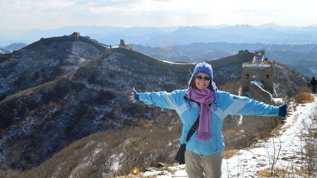 Posing in front of the Great Wall of China (Credit: Credit: Rebecca Isaak)
