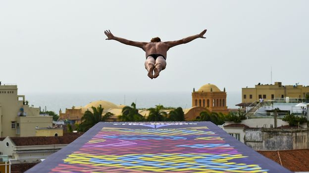 Diving over Cartegena at the Red Bull Cliff Diving World Series (Credit: Credit: Luis Acosta/Getty)