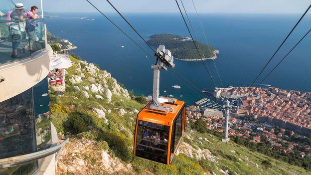 A cable car rides up to Dubrovnik's Mount Srd (Credit: Credit: Paulprescott72/iStock)