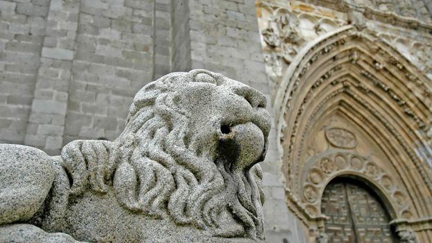 A majestic lion statue guards Ávila's cathedral (Credit: Credit: Javier García Blanco/Thinkstock)