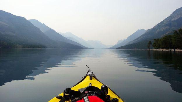 Kayaking beneath the mountains (Credit: Credit: Carol Patterson)