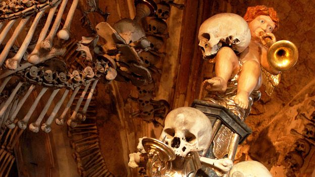 Angels prance on ghoulish skulls (Credit: Credit: Michal Cizek/Getty)