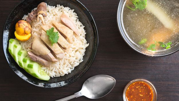 The dish is an ensemble of boiled chicken, rice, chilli sauce and chicken soup (Credit: Credit: Kidsada Manchinda/Alamy)