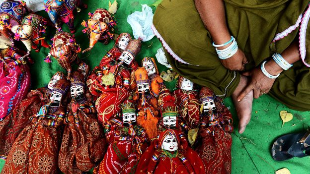 Many residents earn a living by performing with and selling handcrafted puppets (Credit: Credit: AFP/Getty)