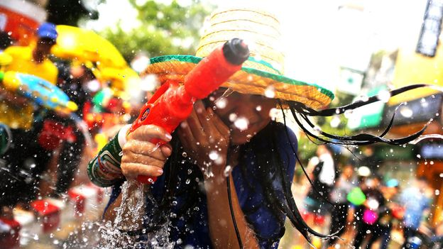The Thai New Year festival is celebrated from 13 to 15 April (Credit: Credit: Taylor Weidman/Getty)