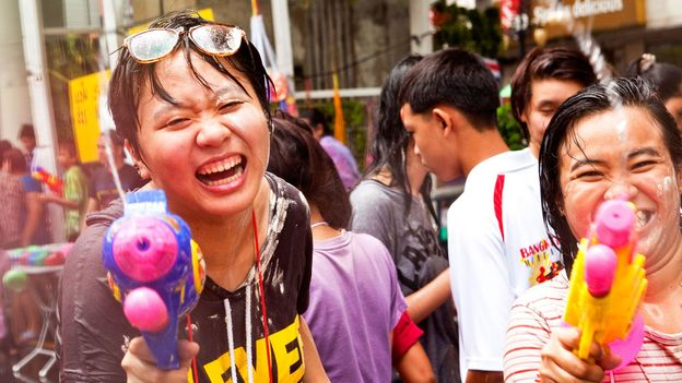 Stepping outside on Songkran means getting drenched by water pistols (Credit: Credit: Jack Kurtz/Getty)