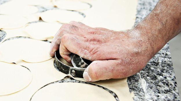 The mpanatigghi dough is cut into perfect circles (Credit: Credit: Antica Dolceria Bonajuto)