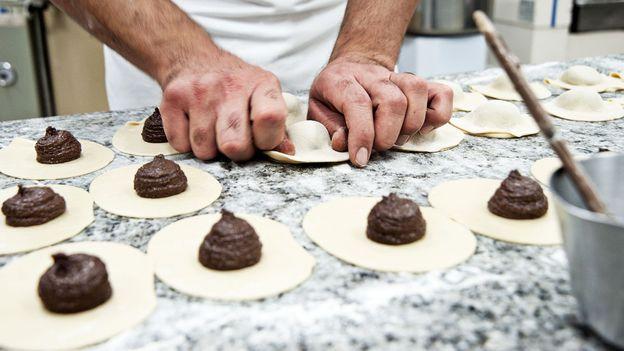 The dough is folded over the chocolate filling into the iconic empanada shape (Credit: Credit: Antica Dolceria Bonajuto)