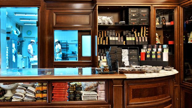 Chocolatiers are busy at work behind the counter of Antica Dolceria Bonajuto (Credit: Credit: Antica Dolceria Bonajuto)