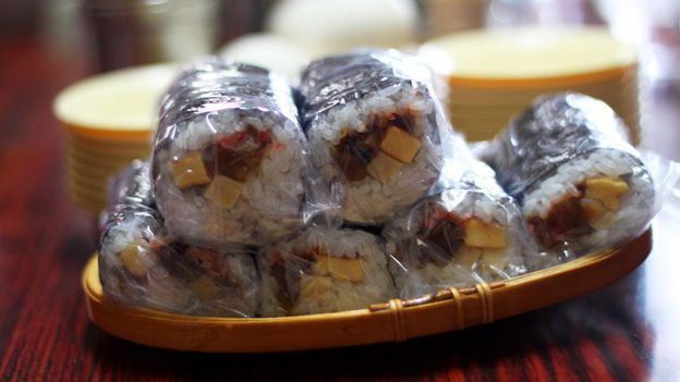 Clingfilm wrapped sushi sits on each table (Credit: Credit: Danielle Demetriou)