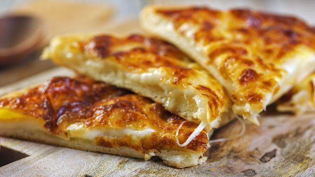 Khachapuri filled with soft cheese (Credit: Credit: Zoonar/Marina Saprunova /Alamy)