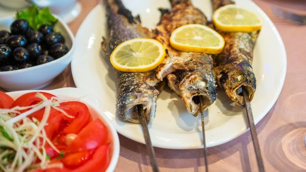 Grilled fish often features in a supra (Credit: Credit: kpzfoto/Alamy)