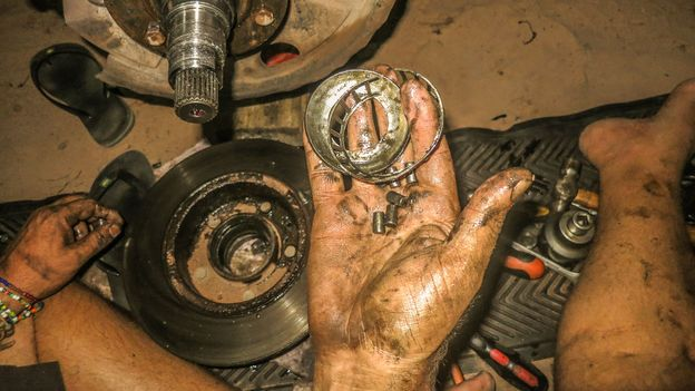 Repairing the wheel bearing, middle of the night, somewhere in Brazil, 2014