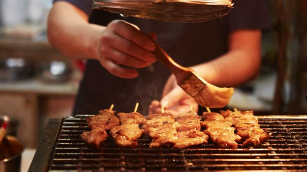Barbecueing meat at a street food stall in Hong Kong (Credit: Credit: Sarah Treleaven)