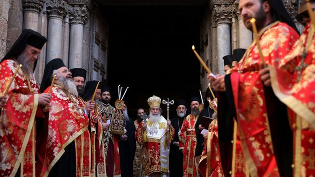 The Greek Orthodox Church holds ceremonies outside the Church of the Holy Sepulchre during Easter celebrations (Credit: Credit: Gali Tibbon/AFP/Getty Images)