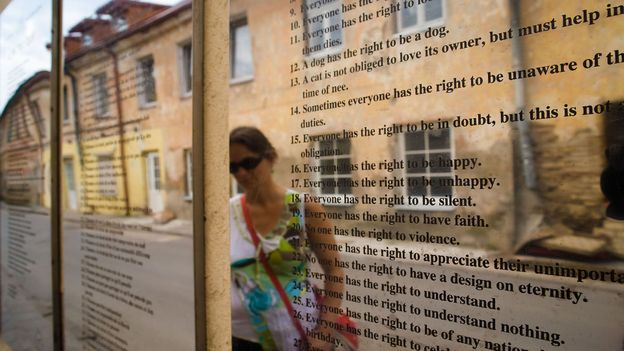 Translations of Užupis' constitution are engraved on mirrored panels that line the Avenue of Constitutions (Credit: Credit: Christian Harberts/Alamy)