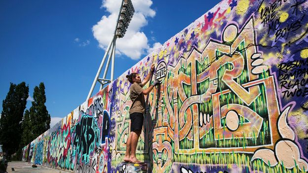 Want to grab a spray can and tag the Berlin Wall? Sure! There's a designated space for that (Credit: Credit: Tom Stoddart/Getty Images)