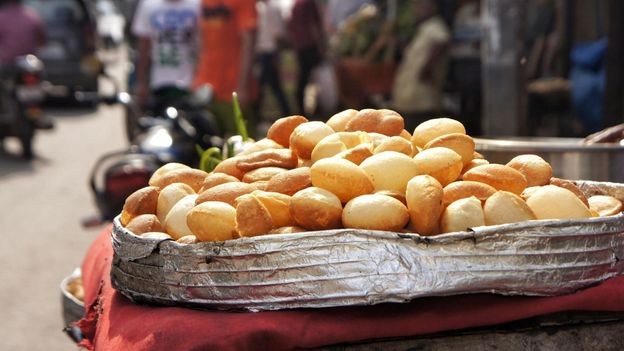 Puris are discs of dough that puff up upon frying to create a hollow core (Credit: Credit: EyeEm/Alamy)