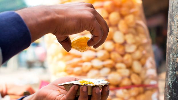 Pani puri is one of the street snacks that many Indians have missed the most during lockdown (Credit: Credit: IndiaPictures/Getty Images)