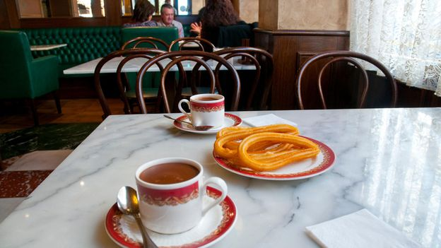 Churros and chocolate is especially popular in Madrid (Credit: Credit: Maria Galan Still/Alamy)