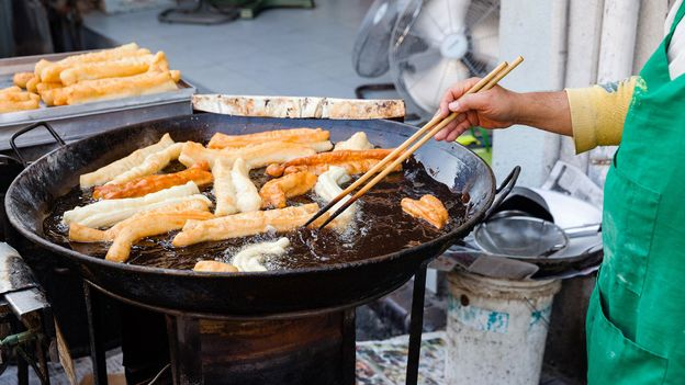 The porra, a plumper cousin of the churro, is similar to Chinese youtiao (Credit: Credit: Evgeny Ermakov/Alamy)