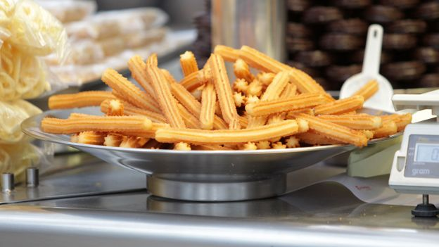 Churros are popular as a walk-around treat at fairs and amusement parks (Credit: Credit: Howard Sayer/Alamy)